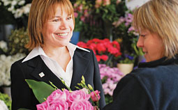 Two women choosing flowers in a florist