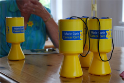 Marie Curie collecting pots