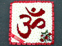 Flower tribute with the Hindu Om symbol